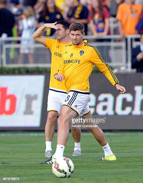 Midfielder Steven Gerrard and forward Robbie Keane of Los Angeles Galaxy warm up prior to the start of their friendly soccer match against FC...