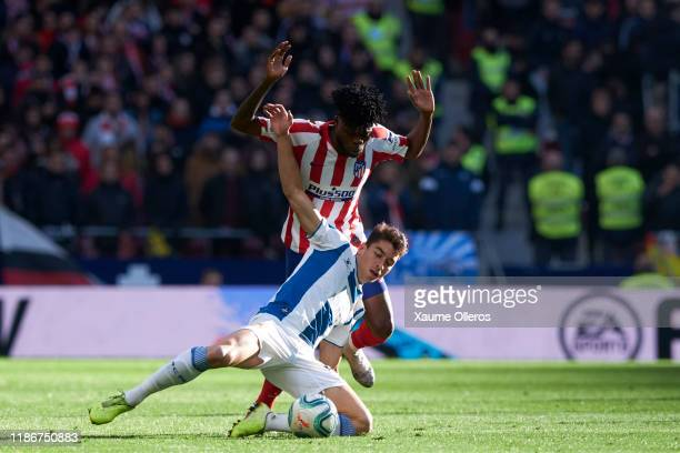Midfielder Thomas of Atletico de Madrid fights for the ball with Midfielder Marc Roca of RCD Espanyol during the Liga match between Club Atletico de...