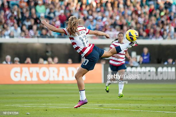 Midfielder Tobin Heath of the United States attempts a backwards kick during the game against Scotland at EverBank Field on February 9 2013 in...