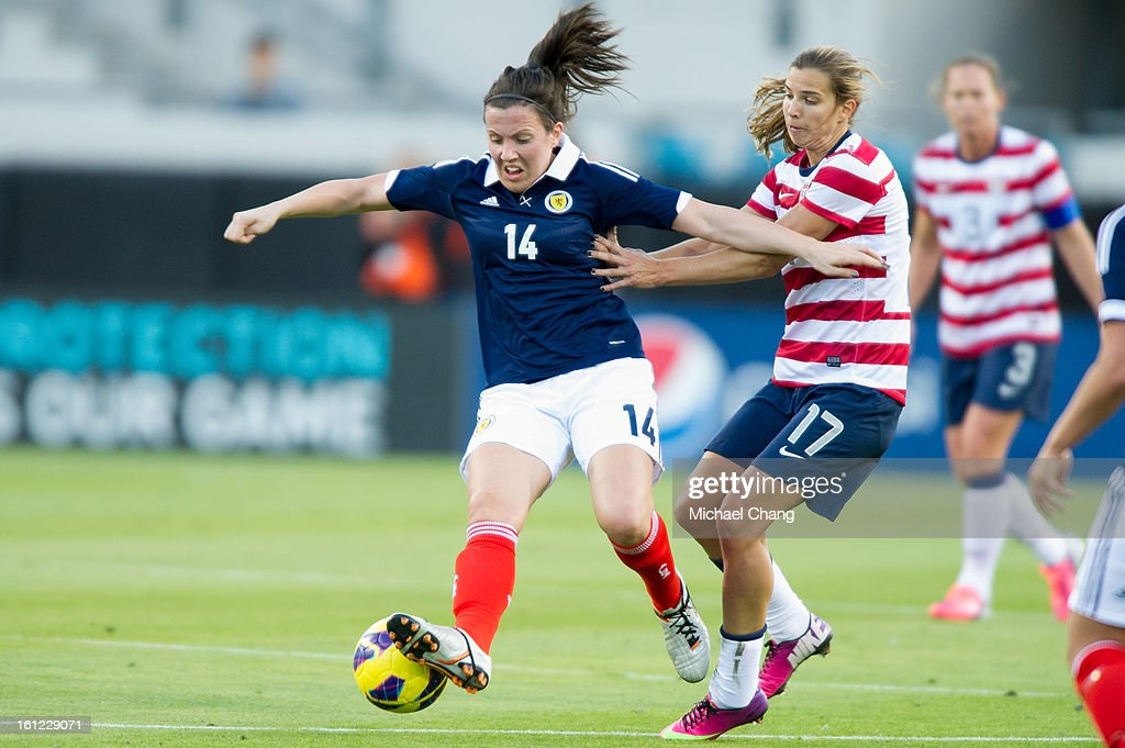 Midfielder Tobin Heath #17 of the U.S. and midfielder Leanne Crichton #14 of Scotland battle for a ball during the first half against Scotland at EverBank Field on February 9, 2013 in Jacksonville, Florida. At half time the United States lead Scotland 2-0.