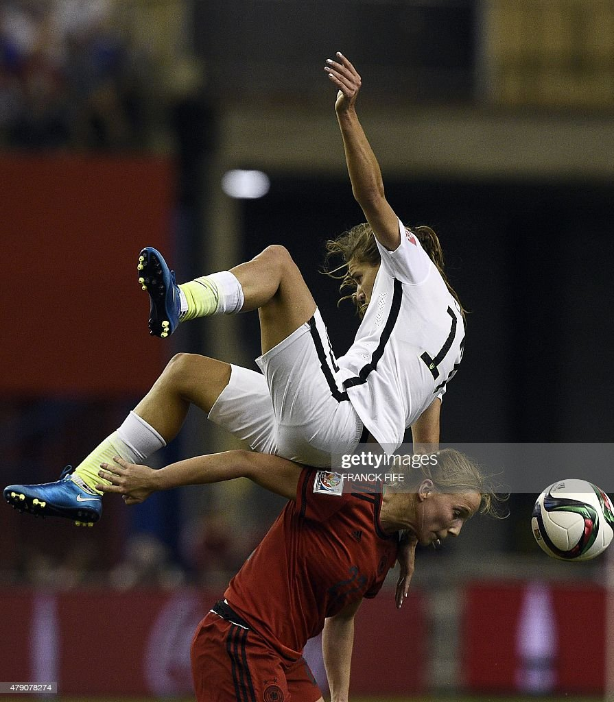 USA midfielder Tobin Heath (TOP) vies with Germany's midfielder Tabea Kemme during the semi-final football match between USA and Germany during their 2015 FIFA Women's World Cup at the Olympic Stadium in Montreal on June 30, 2015.