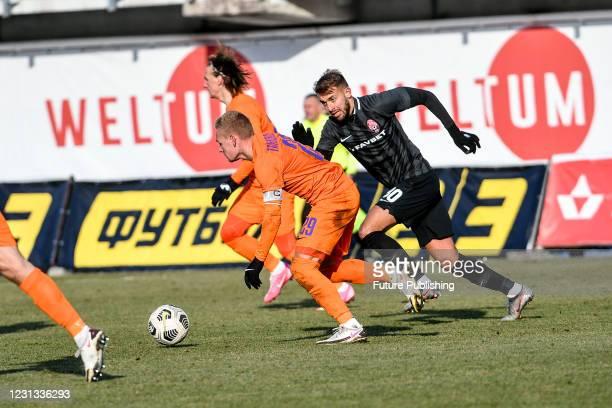 Midfielder Viacheslav Tankovskyi of FC Mariupol and midfielder Vladlen Yurchenko of FC Zorya Luhansk are seen in action during the Ukrainian Premier...