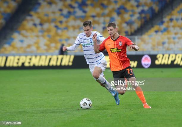 Midfielder Volodymyr Shepeliev of FC Dynamo Kyiv and defender Valeriy Bondar of FC Shakhtar Donetsk are seen in action during the Ukrainian Premier...