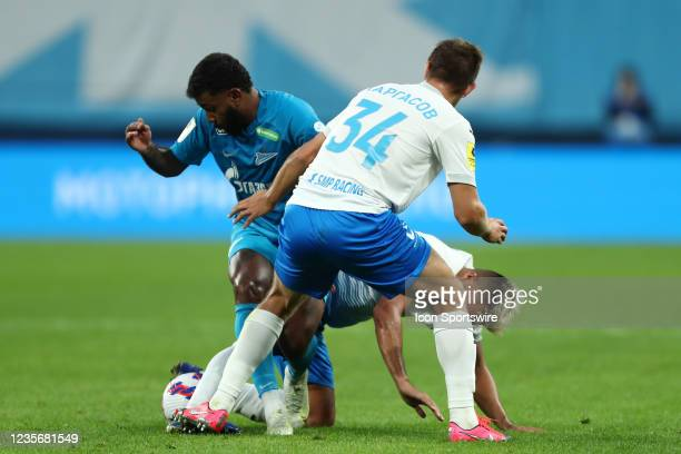 Midfielder Wendel of FC Zenit, midfielder Christian Noboa of FC Sochi and defender Timofei Margasov of FC Sochi vie for the ball during Russian...