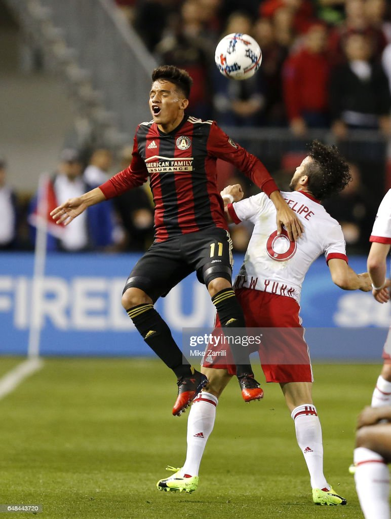 Midfielder Yamil Asad #11 of Atlanta United and midfielder Felipe #8 of the New York Red Bulls battle for a head ball during the game at Bobby Dodd Stadium on March 5, 2017 in Atlanta, Georgia.