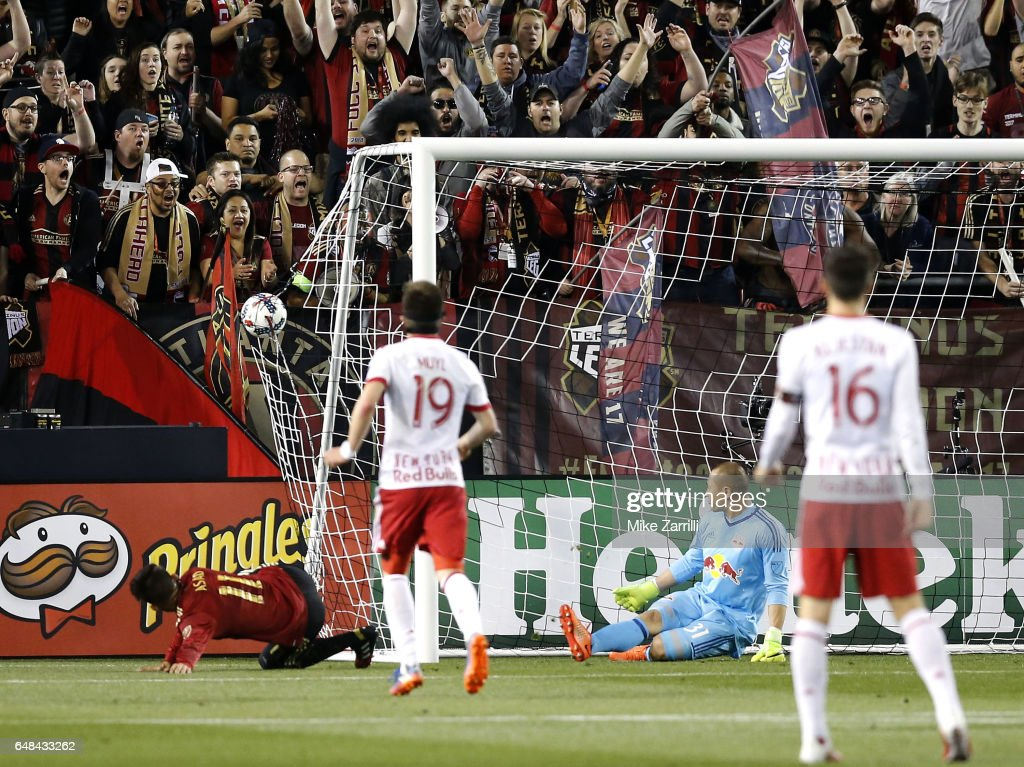 Midfielder Yamil Asad #11 of Atlanta United (left) scores the first goal of the game, and the first goal in Atlanta United history, during the game against the New York Red Bulls at Bobby Dodd Stadium on March 5, 2017 in Atlanta, Georgia.