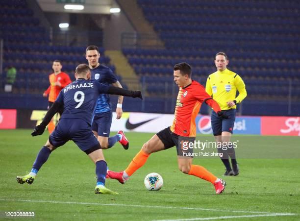 Midfielder Yevhen Konoplyanka of FC Shakhtar Donetsk and midfielder Levan Arveladze of FC Desna Chernihiv are seen in action during the Ukrainian...