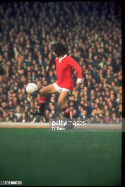 Midfielder/forward George Best on the pitch during a First Division match between Manchester United F.C. And Huddersfield Town F.C., circa 1971.