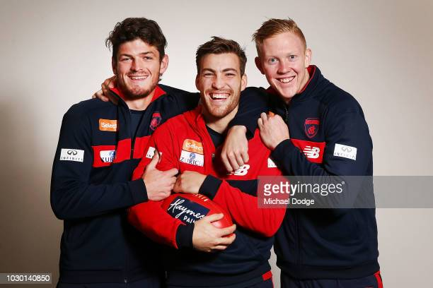 Midfielders Angus Brayshaw Jack Viney and Clayton Oliver of the Demons pose during a Melbourne Demons AFL media opportunity at AAMI Park on September...