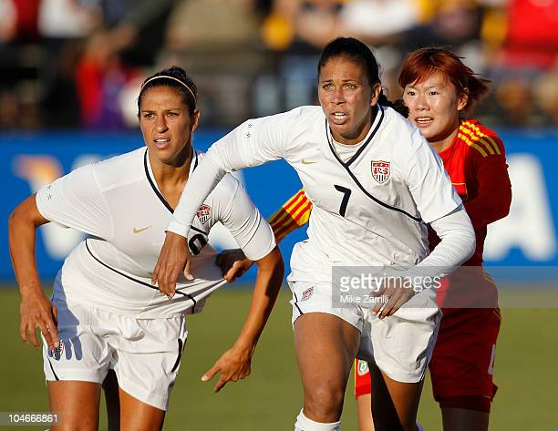 Midfielders Carli Lloyd and Shannon Boxx of the US Women's National Soccer Team and midfielder Wenjia Xu of the People's Republic of China Women's...