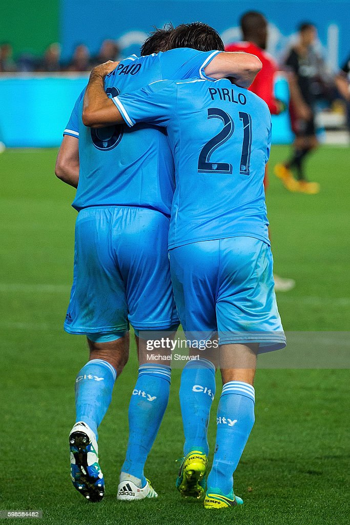 Midfielders Frank Lampard #8 (L) and Andrea Pirlo #21 of New York City FC celebrate during the match vs D.C. United at Yankee Stadium on September 1, 2016 in New York City. New York City FC defeats D.C. United 3-2.