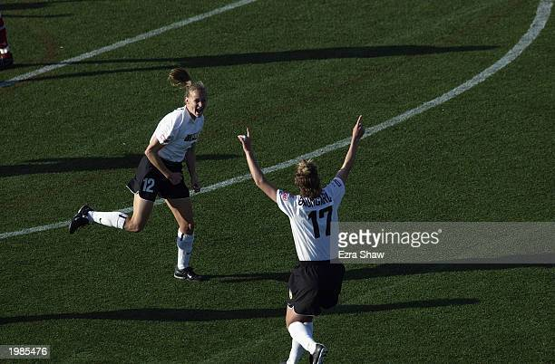 Midfielders Krista Davey of the New York Power celebrates her game winning goal with teammate Justi Baumgardt as they defeat the Philadelphia Power...