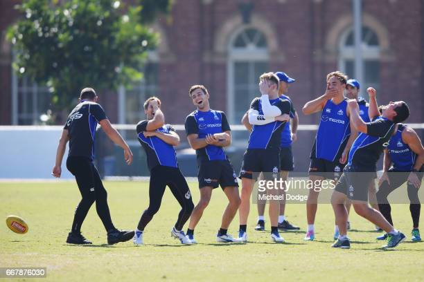 Midfielders reacts after Ben Cunnington of the Kangaroos dropped a ball in the slips during a North Melbourne Kangaroos AFL training session at Arden...