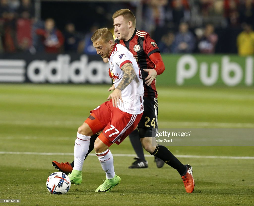 Midfilelder Daniel Royer #77 of the New York Red Bulls dribbles past midfielder Julian Gressel #24 of Atlanta United during the game at Bobby Dodd Stadium on March 5, 2017 in Atlanta, Georgia.