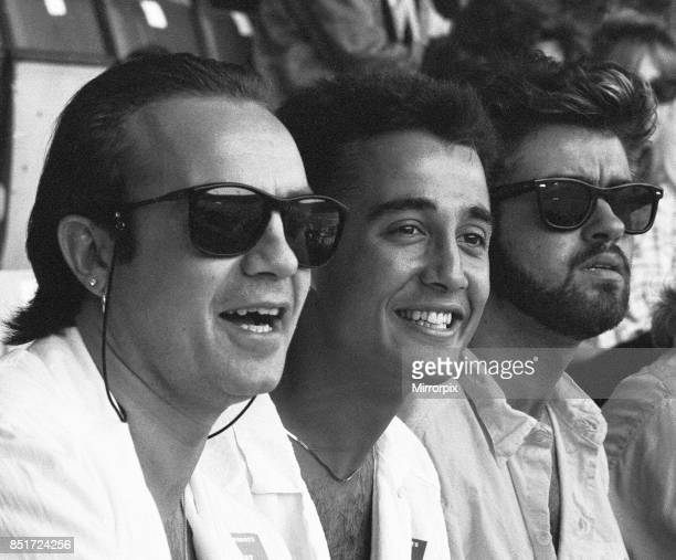 Midge Ure andrew Ridgeley and George Michael in the audience during the opening of the Live Aid Concert at Wembley Stadium 13th July 1985