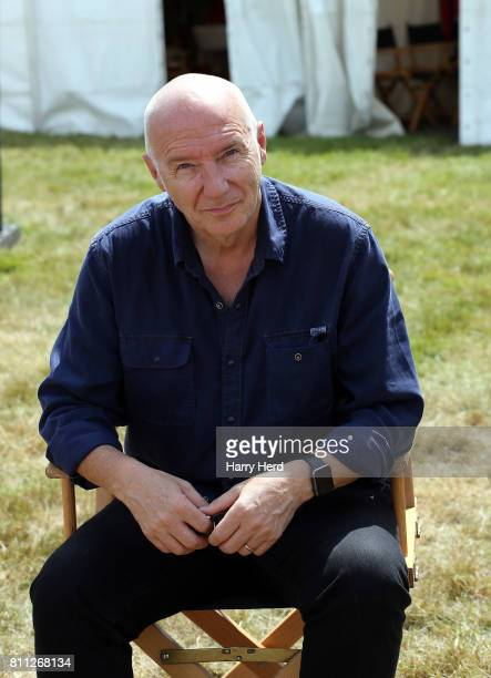 Midge Ure relaxes backstage on Day 3 of Cornbury Festival at Great Tew Park on July 9 2017 in Oxford England