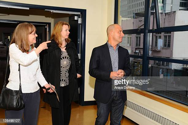 Midge Wilson of the Bay Area Women's Center VP/GMM of Sears Apparel Julie Cashion and Sears Executive Vice President John Goodman tour the Tenderloin...