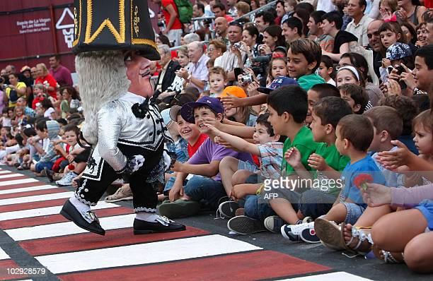 A midget dances during the Dance of the Midgets of the 67th descent of the Virgin of the Snows in Santa Cruz de La Palma on the Spanish Canary Island...