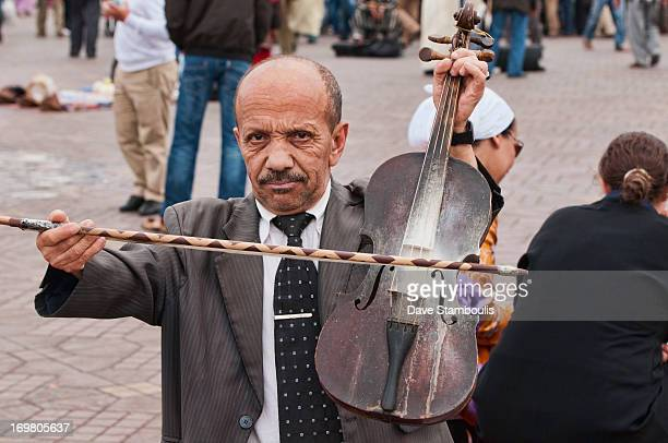 CONTENT] midget violinist at the Djemma el Fna Square in Marrakech Morocco
