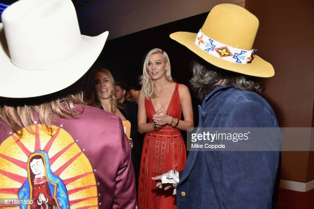 Midland and Karlie Kloss pose with Moet Chandon during the 51st Annual CMA Awards at Bridgestone Arena on November 8 2017 in Nashville Tennessee