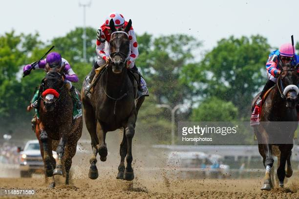 Midnight Bisou with Jockey Mike Smith up wins the Grade I Odgen Phipps Stakes at Belmont Park Race Track on June 8 2019 in Elmont New York