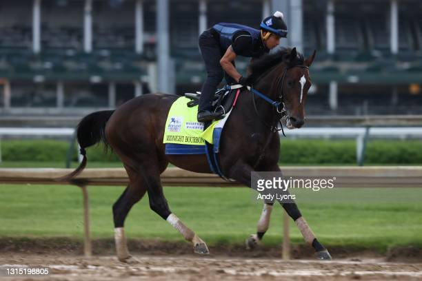 Midnight Bourbon runs on the track during the training for the Kentucky Derby at Churchill Downs on April 29, 2021 in Louisville, Kentucky.