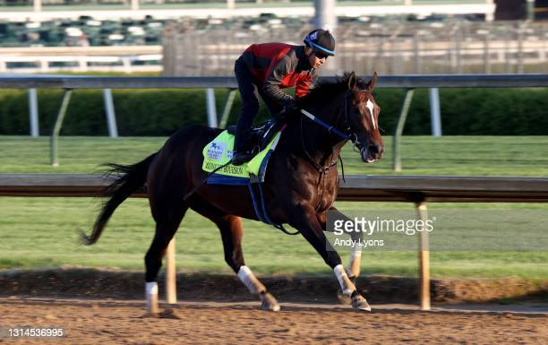 Midnight Bourbon runs on the track during training for the Kentucky Derby at Churchill Downs on April 26, 2021 in Louisville, Kentucky.
