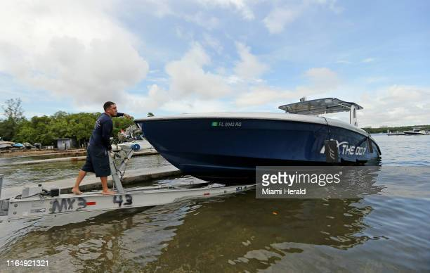 Midnight Express Powerboats employee Ray Vazquez pull out his boat from the Haulover Marine Center on Friday Aug 30 2019 in Miami Beach as they...