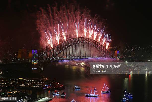 Midnight fireworks are seen on New Year's Eve on Sydney Harbour on January 1 2017 in Sydney Australia
