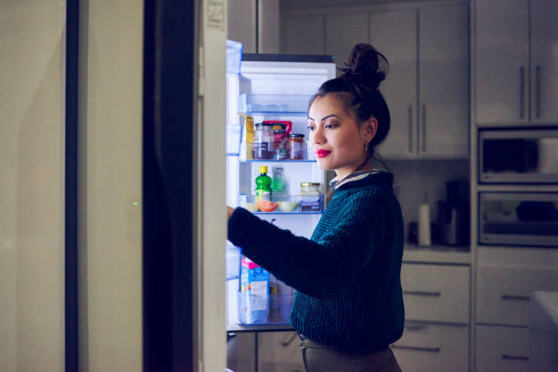 midnight snack - eating from fridge stock pictures, royalty-free photos & images