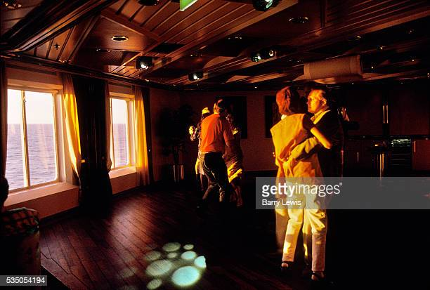 Midnight sun disco on the Coastal Express which sails between Bergen and Kirkenes For more than a century the coastal steamer Hurtigruten has been...
