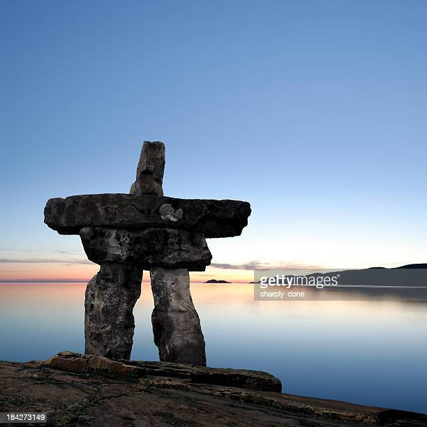 xxl midnight sun inukshuk - inuit stock pictures, royalty-free photos & images