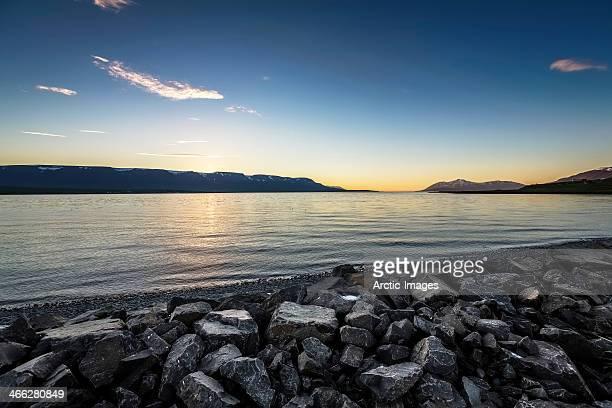 Midnight sun over fjord