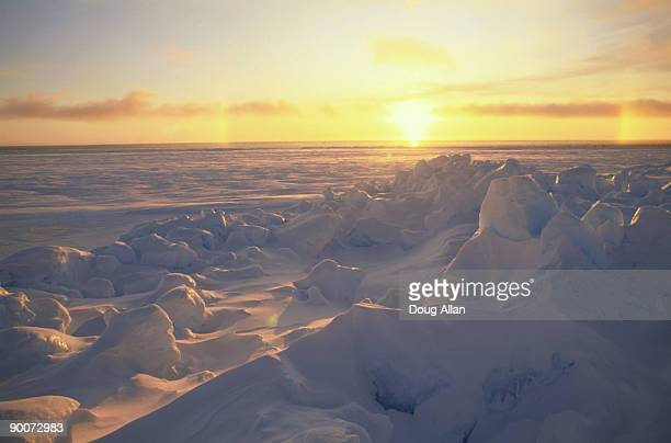 midnight sun over the spring sea ice of lancaster sound, canadian arctic