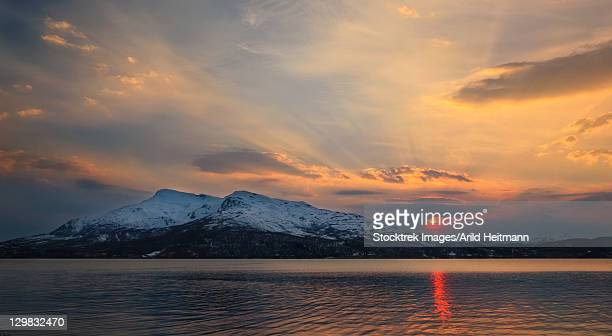Midnight Sun over Tjeldsundet and the Saetertinden Mountain in Troms County, Norway.
