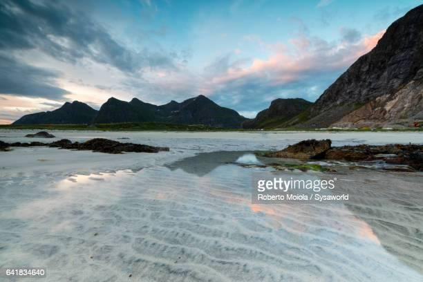 Midnight sun reflected in the clear sea Skagsanden