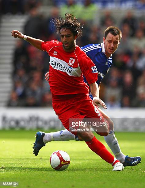 Mido of Middlesbrough holds back John Terry of Chelsea during the Barclays Premier League match between Middlesbrough and Chelsea at the Riverside...