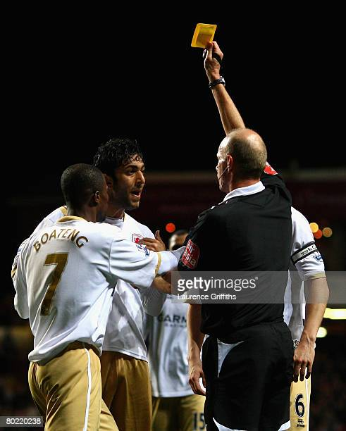 Mido of Middlesbrough is booked by Referee Steve Bennett over his penalty decision during the Barclays Premier League match between Aston Villa and...