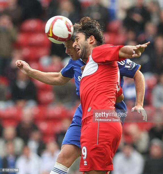 Mido of Middlesbrough outjumps Wayne Bridge of Chelsea during the Barclays Premier League match between Middlesbrough and Chelsea at the Riverside...