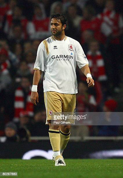 Mido of Middlesbrough walks off the pitch after being shown the red card by referee Mark Halsey after fouling Gael Clichy of Arsenal during the...