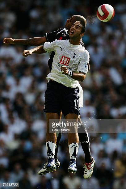 Mido of Tottenham and Zat Knight of Fulham battle for the header during the Barclays Premiership match between Tottenham Hotspur and Fulham at White...