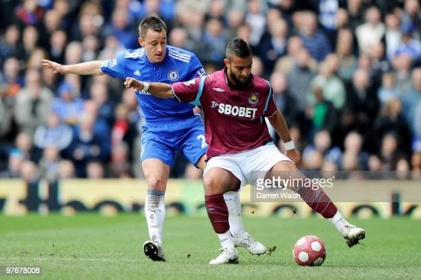 Mido of West Ham is challenged by John Terry of Chelsea during the Barclays Premier League match between Chelsea and West Ham United at Stamford...