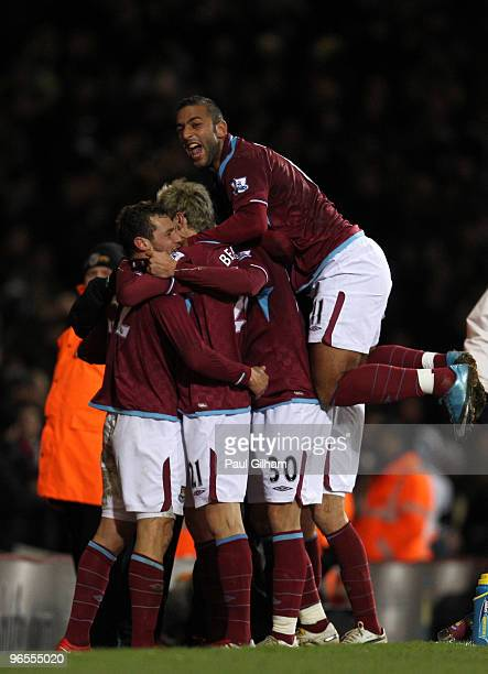Mido of West Ham United celebrates with Alessandro Diamanti of West Ham United after Alessandro Diamanti scored the first goal for West Ham United...
