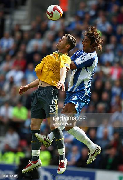 Mido of Wigan Athletic in action with Gary Cahill of Bolton Wanderers during the Barclays Premier League match between Wigan Athletic and Bolton...