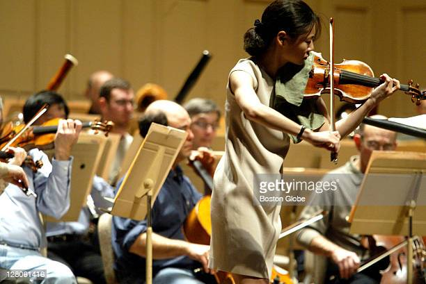 Midori a violinist performing with the Boston Symphony Orchestra at Symphony Hall