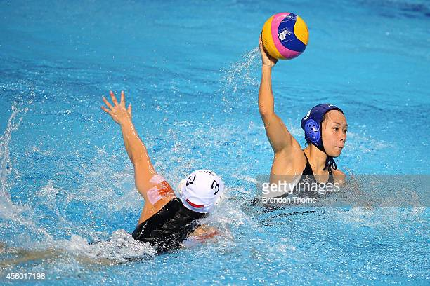 Midori Sugiyama of Japan shoots for goal in the Women's Single Round Robin Waterpolo during day five of the 2014 Asian Games at Dream Park Aquatics...