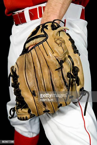 Midsection of a baseball player wearing a baseball glove