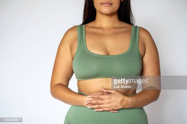 midsection of a fat woman in underwear - abdomen stock pictures, royalty-free photos & images