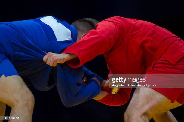 midsection of athletes wrestling - cetkauskas stock pictures, royalty-free photos & images