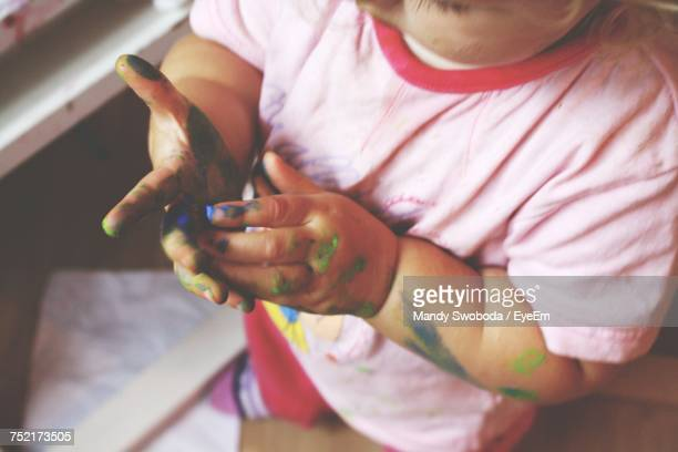 Midsection Of Baby With Paint On Hands